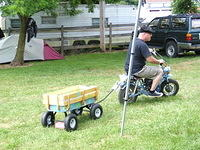 Scott on Skip and Lori's 'mini-bike' with wagon in tow!
